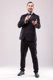 Young Showman presenter with microphone against white background. Royalty Free Stock Image