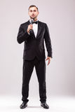 Young Showman presenter with microphone against white background. Royalty Free Stock Photography