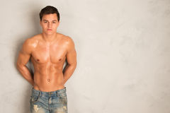Young shredded man against a wall Royalty Free Stock Images