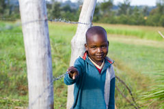 Young Shy African Boy. A young shy boy living in rural Kenya royalty free stock image