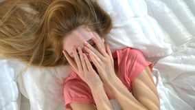 Young shy woman in bed smiling looking at the camera stock video footage