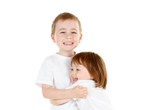 Young siblings hugging Stock Images