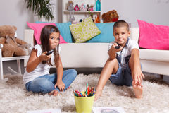 Young siblings watching TV Stock Photography