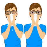 Young sick man ill suffering allergy. Portrait of young sick man ill in two different outfit styles suffering allergy using white tissue on nose on white Royalty Free Stock Images
