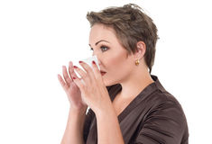 Young sick woman blowing her nose. Suffers cold and flu or allergy Royalty Free Stock Image