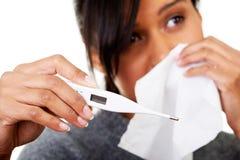 Young sick woman checking her temperature Stock Photos