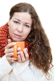 Young sick woman with a cup of tea in her hands Royalty Free Stock Photos