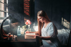 Young sick woman reading book at the hospital Stock Image