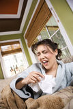 Young Sick Woman Sneezing Stock Images