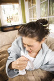 Young Sick Woman Sneezing Stock Image