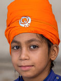 Young Sikh boy visiting the Golden Temple in Amritsar, Punjab, India. Royalty Free Stock Photo