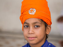 Young Sikh boy visiting the Golden Temple in Amritsar, Punjab, India. Stock Photography