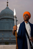 Young Sikh Man Spear at Paonta Sahib. PAONTA SAHIB - MAY 22: A young Sikh man brandishing a spear at the Paonta Sahib Gurudwara, famous for its past warriors May royalty free stock images