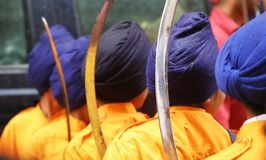Young Sikhs. Young Sikh men line up for NYC's Sikh Day Parade Royalty Free Stock Image