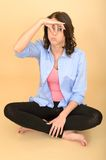 Young Silly Attractive Woman Sitting on the Floor Holding Nose Royalty Free Stock Photography