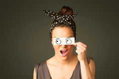 Young silly girl looking with hand drawn eye balls on paper. Concept Stock Images