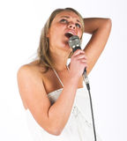 Young singer. Young woman with microphone stock photography