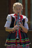 Young singer girl at clarinet from Poland in traditional costume Stock Image