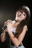 Young singer girl at studio Stock Images