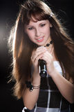 Young singer girl at studio Stock Photography