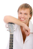 Young singer leans elbows on guitar and laughs Stock Image