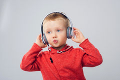 Young singer. Little boy with headphones. Stock Photos