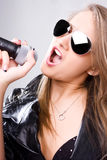 Young singer with microphone Stock Photo
