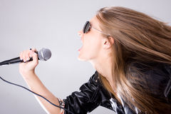 Young singer with microphone Stock Photos