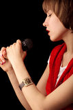 Young singer with microphone Stock Image