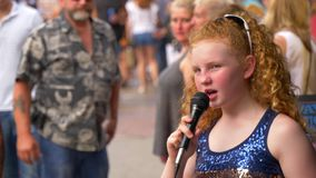 Young singer and street musician performing on Broadway in Nashville - NASHVILLE, UNITED STATES - JUNE 16, 2019. Young singer and street musician performing on stock video footage
