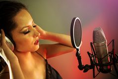 Young singer with studio microphone Royalty Free Stock Photos