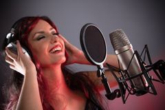 Young singer with studio microphone Stock Photos