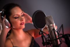 Young singer with studio microphone Royalty Free Stock Images