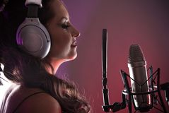 Young singer with studio microphone Stock Images