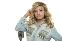 Young Singer woman with microphone Stock Photo