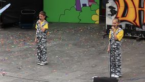 Young singers. Boy and girl singing a song stock video footage