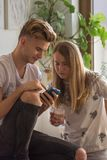 Sister and brother, discuss and view images on a mobile phone. Young sister and brother, discuss and view images on a mobile phone Stock Photography