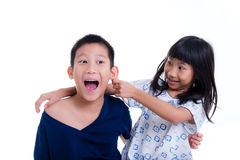 Young sister playfully took his brother Royalty Free Stock Photo