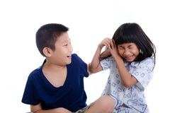 Young sister playfully took his brother Royalty Free Stock Image