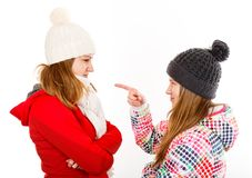 Young sisters arguing. Portrait photo of beautiful young sisters arguing royalty free stock photo