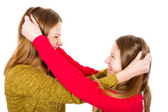 Young sisters fighting Stock Image