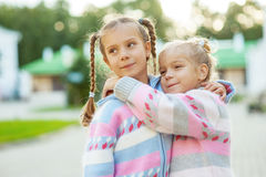 Young sisters hugging Stock Photo