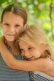 Young sisters hugging Stock Images
