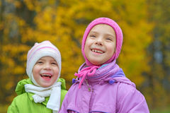Young sisters laughing and hugging Royalty Free Stock Image