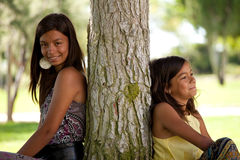 Young sisters at the park Royalty Free Stock Photos