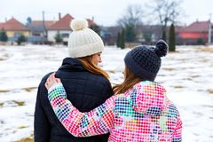 Young sisters walking in the park in wintertime. Photo of young sisters walking in the nature in wintertime Stock Images