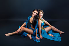 Young sitting beautiful belly dancers Stock Photo