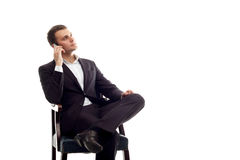 Young sitting business man talking phone on white Stock Photos