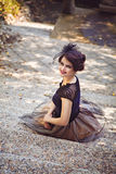 Young Sitting Woman In Vintage Dress On The Steps Royalty Free Stock Photo