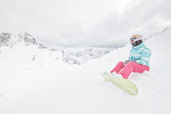 Young sitting woman with snowboard Stock Photos